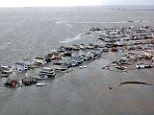 This picture provided by the US Coast guard shows flooded homes in Tuckerton, New Jersey