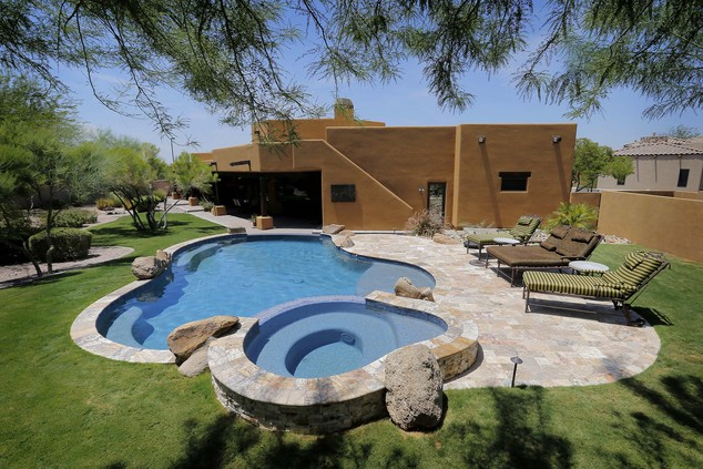 This is an exterior view of a luxury custom home with a listing price of $1 million on Wednesday, July 30, 2014 in Mesa, Ariz. The more than 4,000-square-foo...