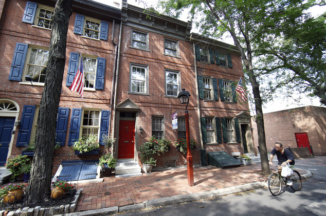A row house on a tree-shaded street is for sale and is listed at $995,000 in the Society Hill neighborhood of Philadelphia on Wednesday, July 30, 2014. The 3...