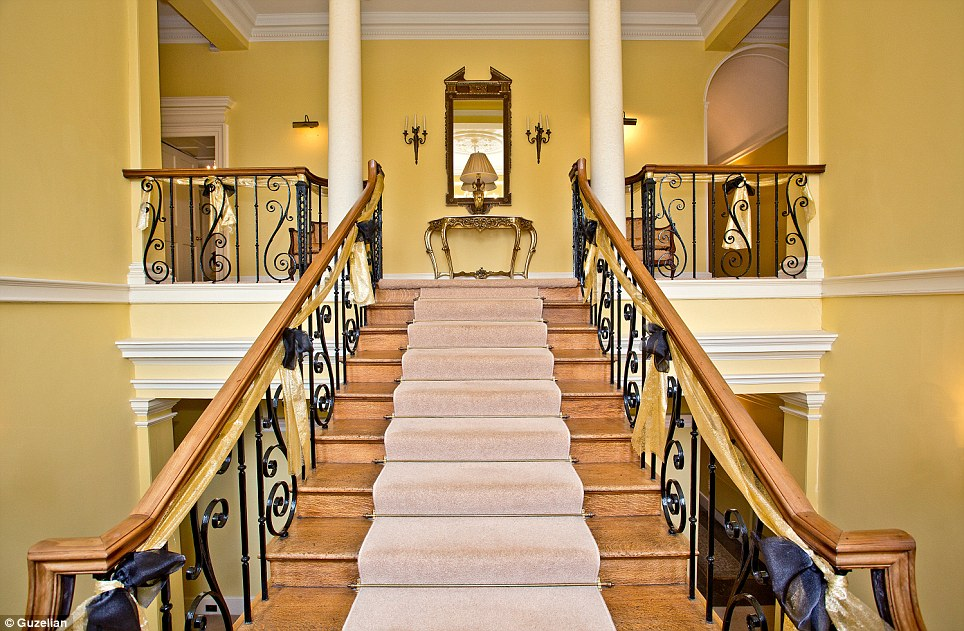 Grand: The carpet-lined stairs, with gold ribbon attached to the bannisters, leads up to the mansion's four bedrooms