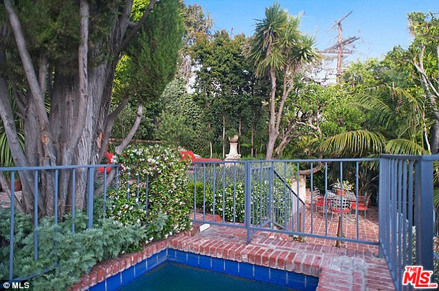 Take me to the place I Love: The property boasts a swimming pool, revamped kitchen, library and lush garden