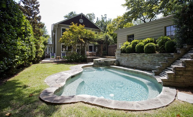 This is an exterior view of the backyard patio and pool area of a three bedroom house listed for sale at $1,095,000 on Wednesday, July 30, 2014, in the Sherw...