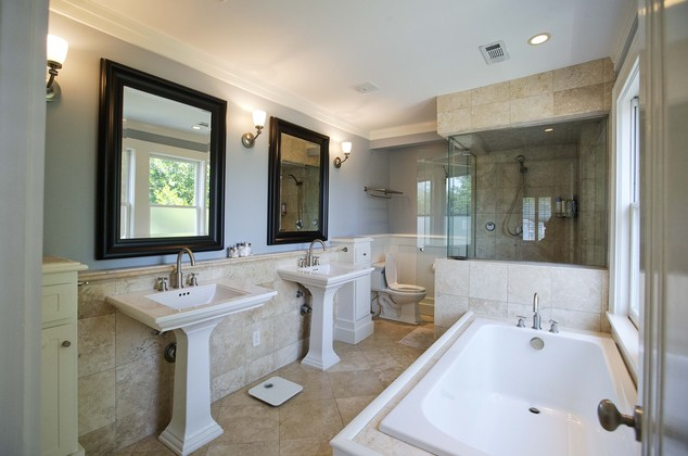 A pair of matching sinks highlight the master bathroom of this three bedroom house listed for sale at $1,095,000, Wednesday, July 30, 2014, in the Sherwood F...