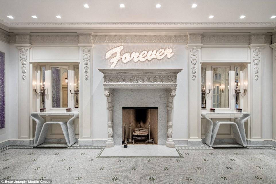 The gallery's lit-up'Forever' sign, by British artists Tim Noble and Sue Webster, is just one of the many art pieces on display in the mansion