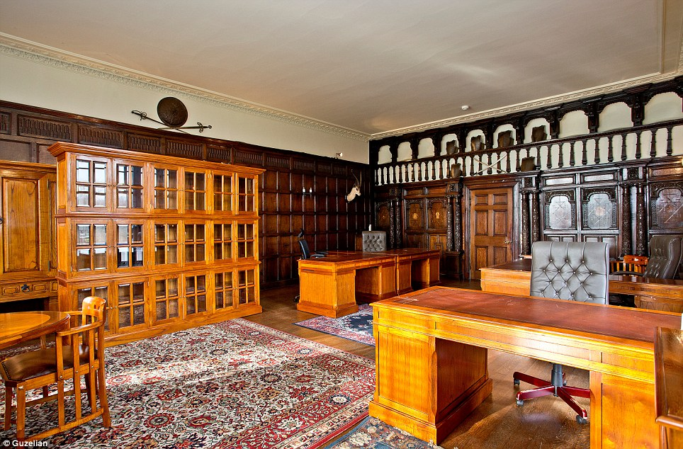 The drawing room could provide adequate space for an office or even a library. Cross swords and a stag's head remain as evidence of the estate's history