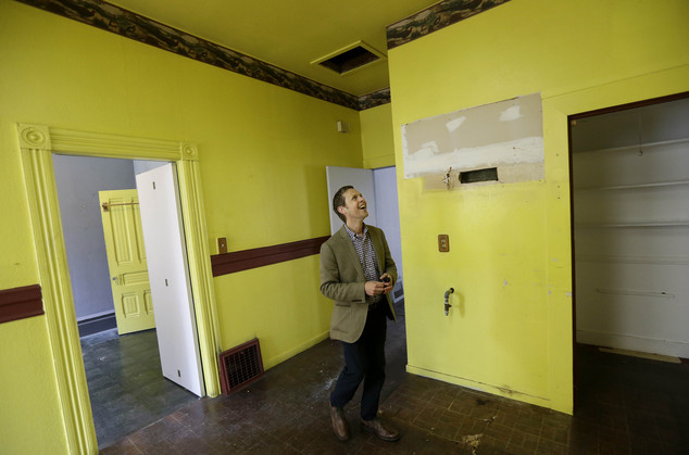 George Limperis, a realtor with Paragon Real Estate Group, smiles as he walks through the kitchen of a property that was recently sold in the Noe Valley neig...
