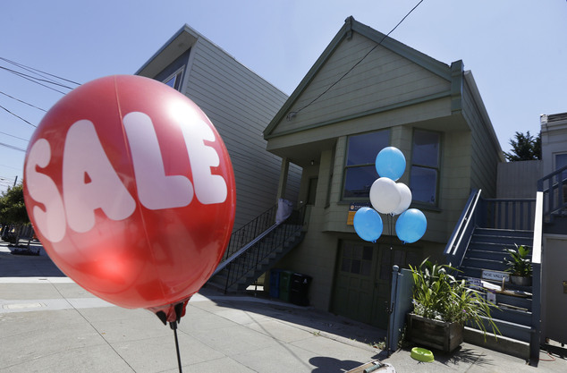 A sale balloon for a nearby store is shown next to a property in the Noe Valley neighborhood just sold for $1.8 million in cash, $600,000 more than its askin...
