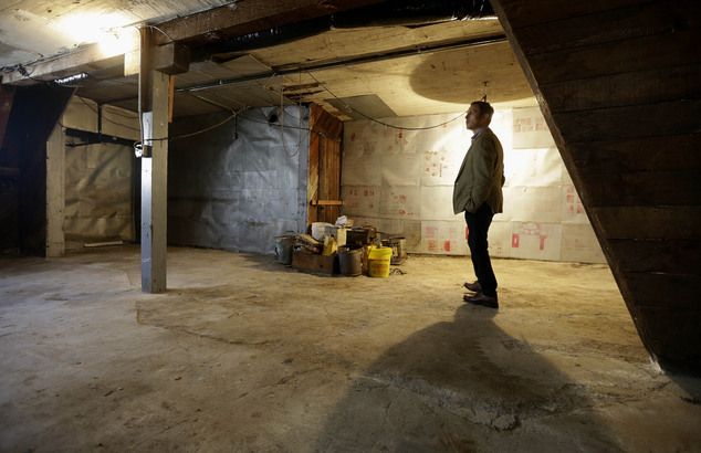 George Limperis, a realtor with Paragon Real Estate Group, stands in the garage of a property in the Noe Valley neighborhood in San Francisco, Wednesday, Jul...