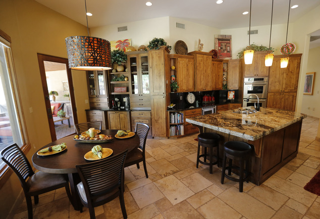 This is an interior view of a luxury home with a listing price of $1 million on Wednesday, July 30, 2014 in Mesa, Ariz. The more than 4,000-square-foot home ...