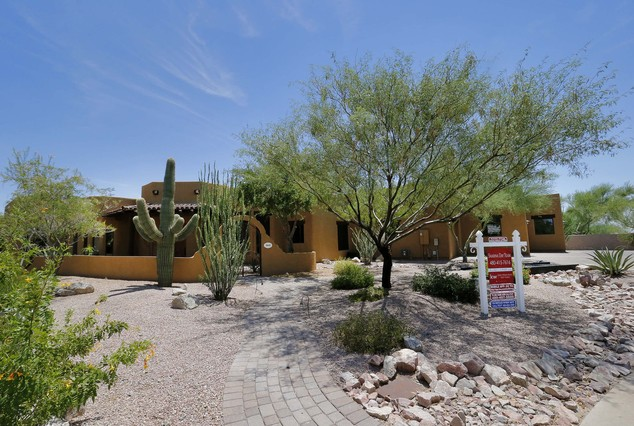 A luxury home with a listing price of $1 million is shown on Wednesday, July 30, 2014, in the Las Sendas community of Mesa, Ariz. The more than 4,000-square-...
