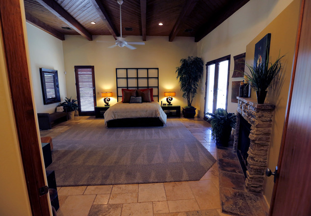 This is a view of the master suite in a luxury home with a listing price of $1 million on Wednesday, July 30, 2014, in the Las Sendas community of Mesa, Ariz...