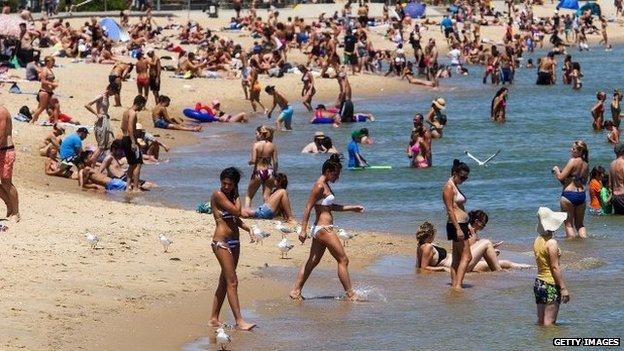 People on St Kilda Beach, Melbourne, Australia, 14 January 2014