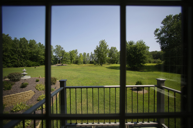 This is the view of an expansive backyard from inside a luxury home on Wednesday, July 30, 2014, in Springfield, Ill. The home is located near The Rail Golf ...