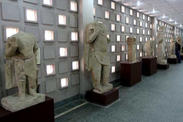 Artefacts coming from Mosul and dating back to the second century B.C are displayed during the official reopening of Iraq's national museum in Baghdad, on Fe...